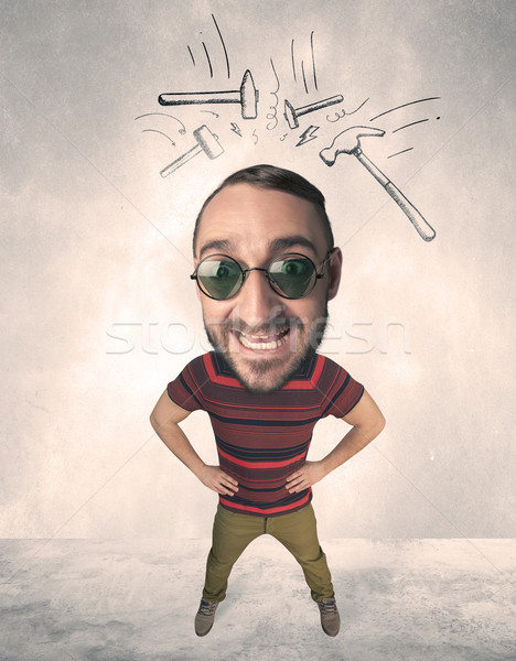 Big head person with drawn hammers Stock photo © ra2studio