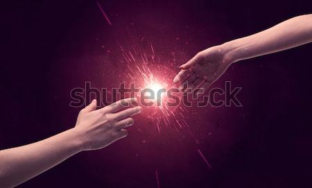 Touching hands light up sparkle in space Stock photo © ra2studio