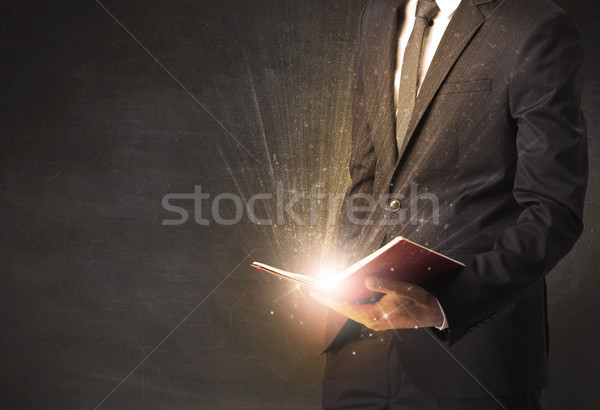 Stock photo: Man holding a book.