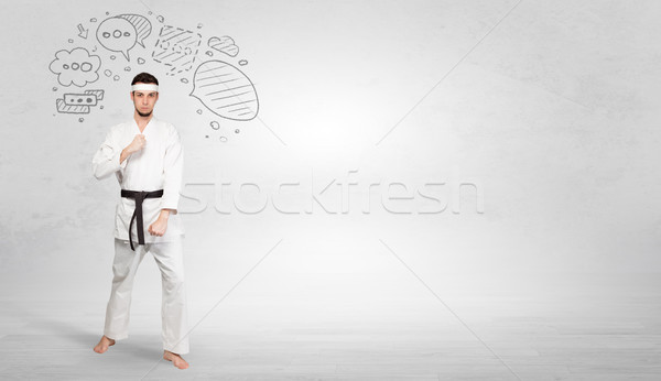 Karate trainer fighting with doodled symbols concept Stock photo © ra2studio