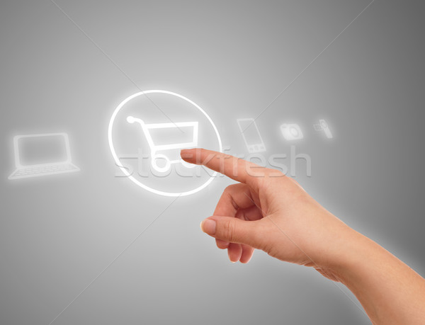 hand choosing shopping cart symbol Stock photo © ra2studio