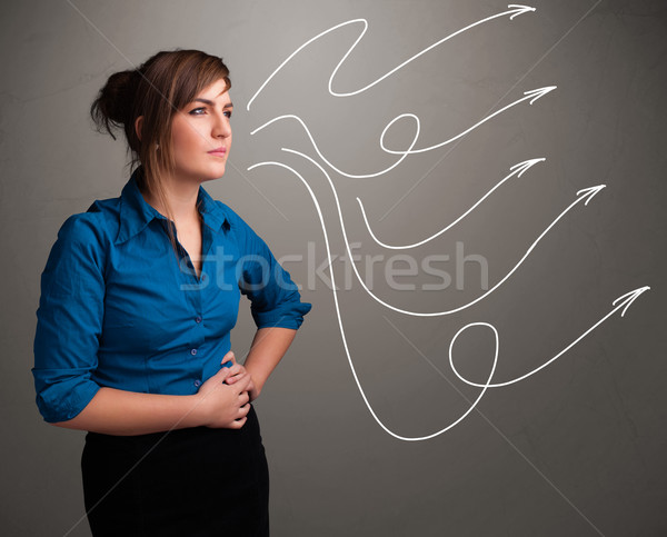 Attractive teenager looking at multiple curly arrows Stock photo © ra2studio