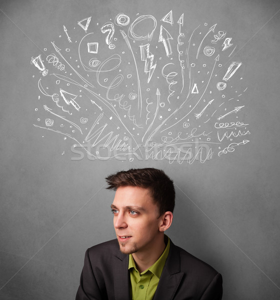 Businessman thinking with sketched arrows above his head Stock photo © ra2studio