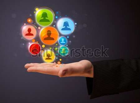 Social media icons coming out of gun shaped hand Stock photo © ra2studio