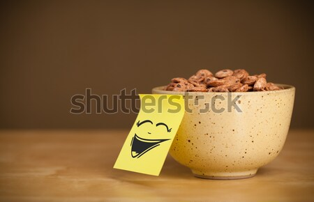 Post-it note with smiley face sticked on cereal bowl Stock photo © ra2studio