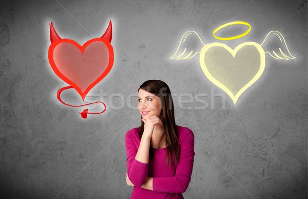 женщину Постоянный ангела дьявол сердцах довольно Сток-фото © ra2studio
