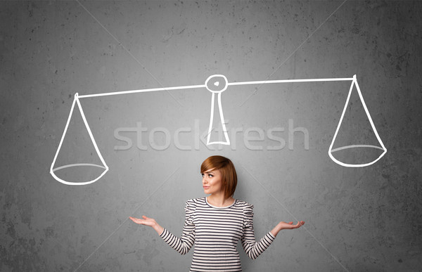 Stock photo: Young woman taking a decision