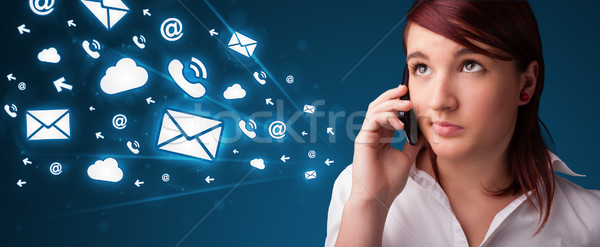 Young lady making phone call with message icons Stock photo © ra2studio