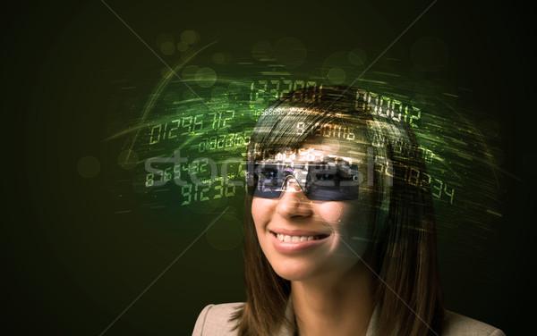 Donna d'affari guardando alto tech numero computer Foto d'archivio © ra2studio