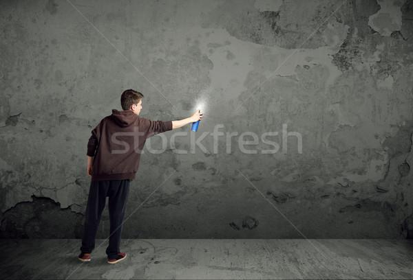 Young urban painter starting to draw Stock photo © ra2studio