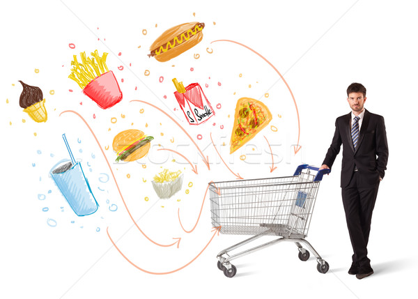 Man with shopping cart with toxic junk food Stock photo © ra2studio