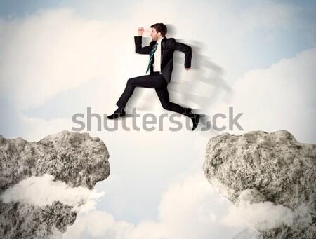 Mutlu iş adamı atlama uçurum adam dağ Stok fotoğraf © ra2studio