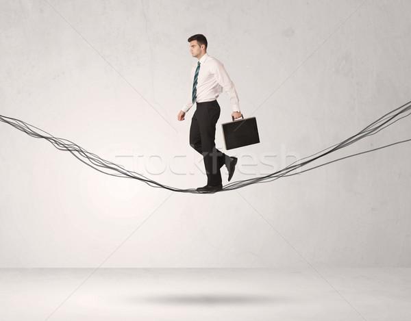 De vendas pessoa equilíbrio cordas empresário Foto stock © ra2studio