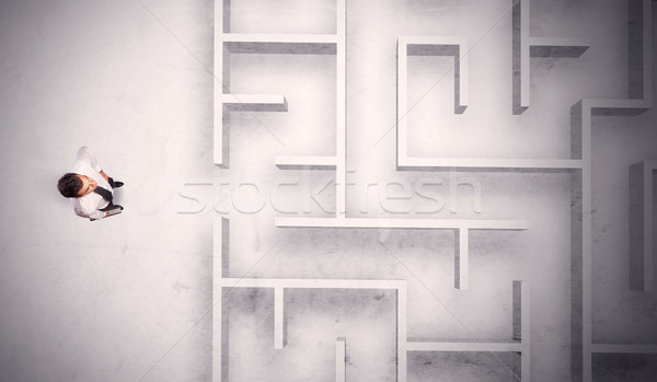 Zavart üzletember áll labirintus fal koszos Stock fotó © ra2studio
