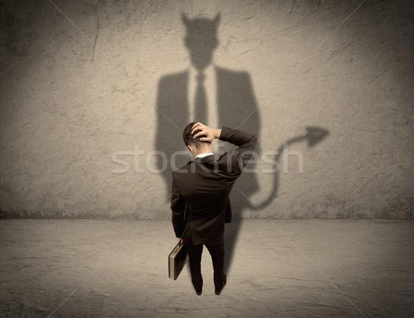 Stockfoto: Verkoper · eigen · duivel · schaduw · ervaren