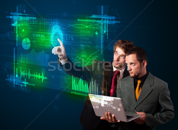 Young business people pressing modern technology panel with fing Stock photo © ra2studio