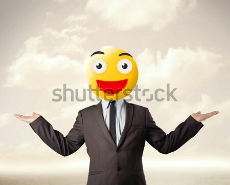 businessman wears yellow smiley face Stock photo © ra2studio