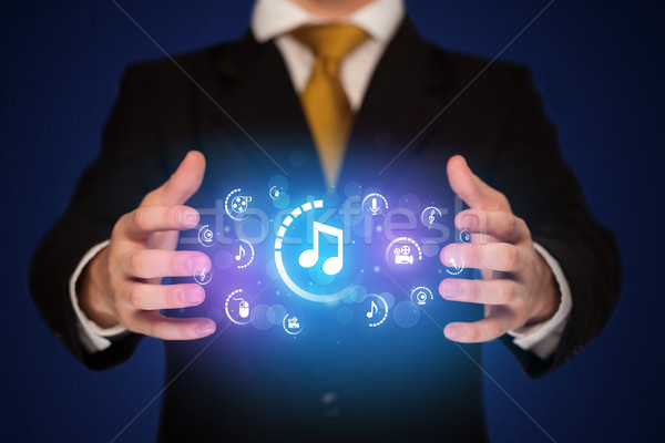 Man holding digital multimedia icons Stock photo © ra2studio