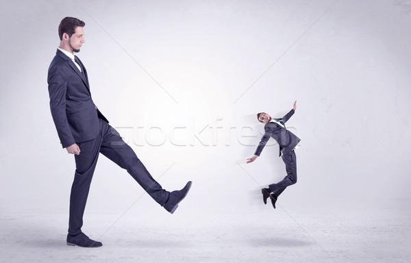 Big man kicking little himself out Stock photo © ra2studio