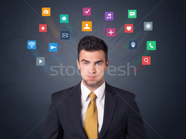 Businessman with colorful apps Stock photo © ra2studio