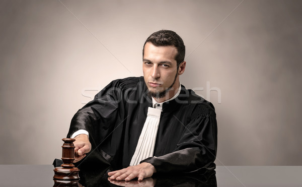 Oldscool young judge in gown Stock photo © ra2studio