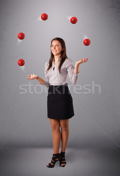 young girl standing and juggling with red balls Stock photo © ra2studio