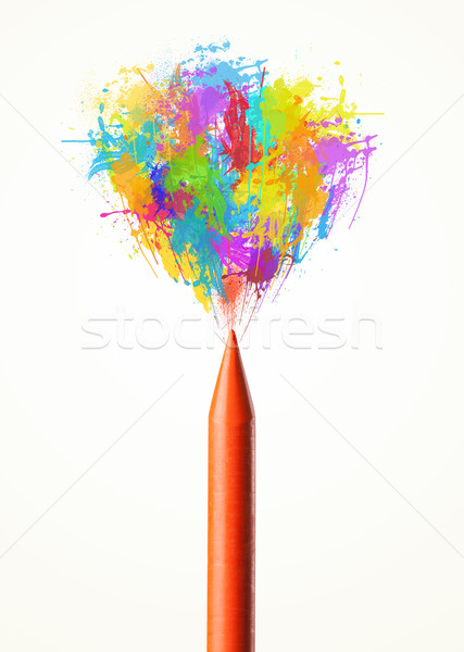 Colored paint splashes coming out of crayon Stock photo © ra2studio