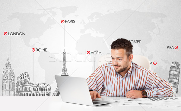 Businessman with world map and major landmarks of the world Stock photo © ra2studio