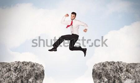 女性実業家 岩 山 小さな 立って エッジ ストックフォト © ra2studio