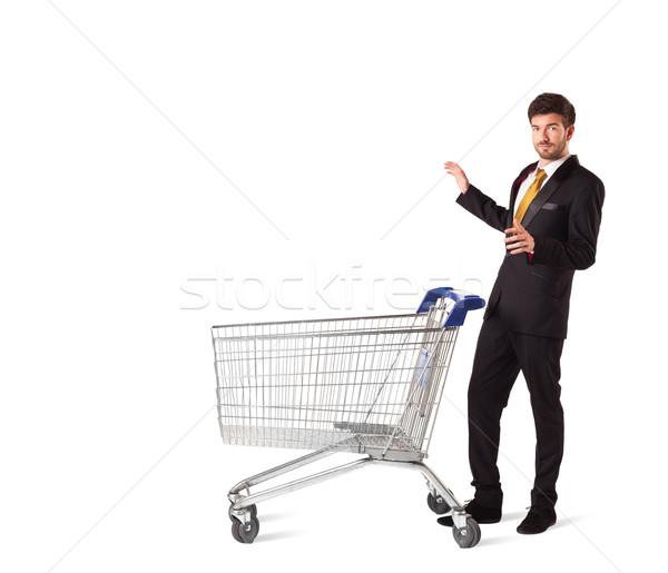 üzletember bevásárlókocsi toló izolált öltöny bolt Stock fotó © ra2studio