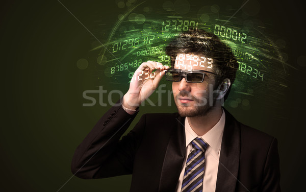 Business man looking at high tech number calculations  Stock photo © ra2studio