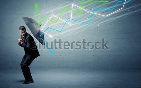 Foto stock: Empresário · guarda-chuva · mercado · de · ações · colorido · dinheiro