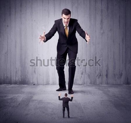 Dev iş adam bakıyor küçük Stok fotoğraf © ra2studio