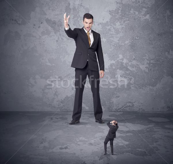 Büyük patron bakıyor küçücük öfkeli Stok fotoğraf © ra2studio