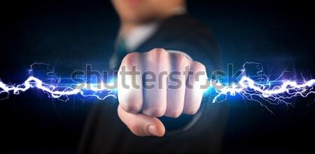 Hombre de negocios electricidad luz manos Foto stock © ra2studio