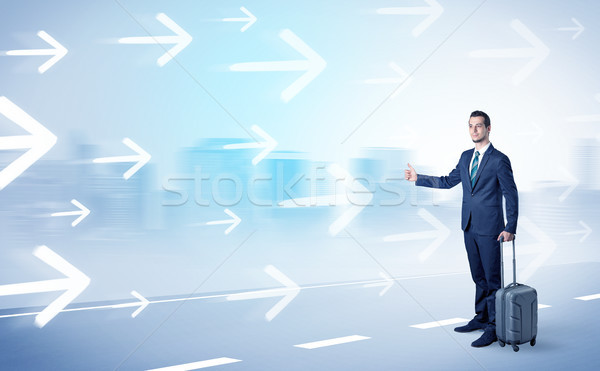 Businessman hitchhiking near the city concept Stock photo © ra2studio