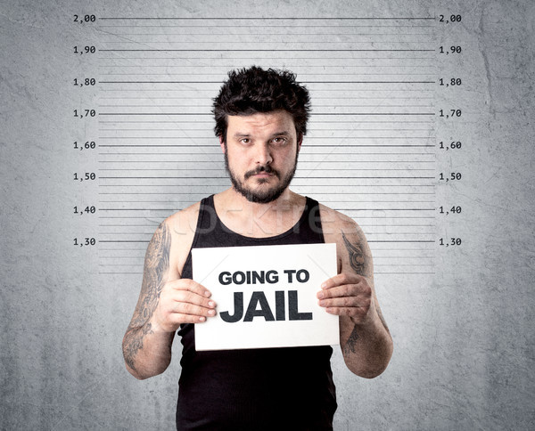 Thief in jail. Stock photo © ra2studio