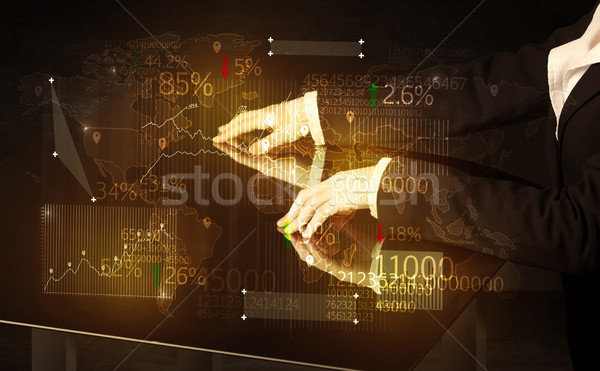 Hands navigate on high tech smart table with business icons Stock photo © ra2studio