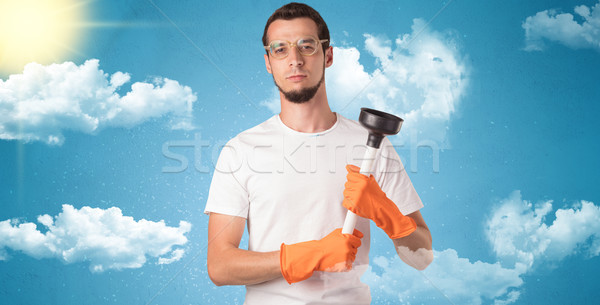 Солнечный экономка оранжевый перчатки облачный мужчины Сток-фото © ra2studio