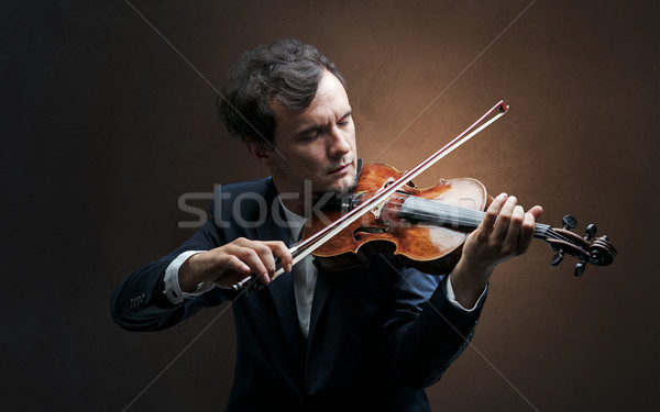 Violinst playing on instrument with empathy Stock photo © ra2studio