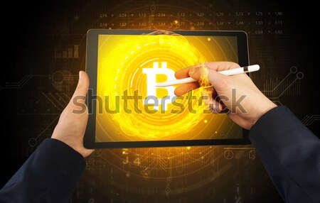 Hand using tablet with cryptocurrency concept Stock photo © ra2studio