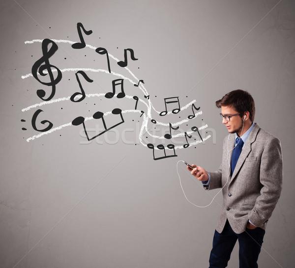 Jóképű fiú énekel zenét hallgat hangjegyek ki Stock fotó © ra2studio