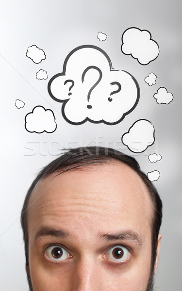 Young guy with question mark over his head Stock photo © ra2studio