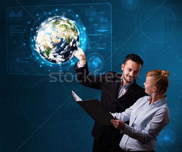 Fiatal pér megérint 3D Föld panel boldog Stock fotó © ra2studio