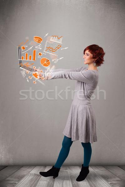 Bella signora notebook grafici statistiche Foto d'archivio © ra2studio