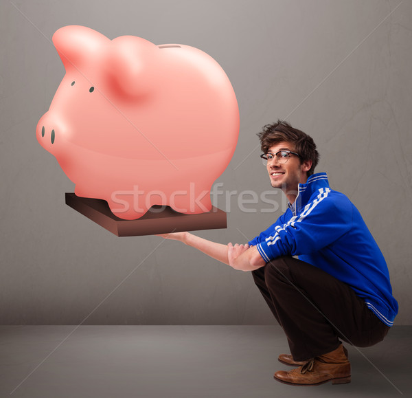 Homem bonito enorme poupança piggy bank bonito Foto stock © ra2studio
