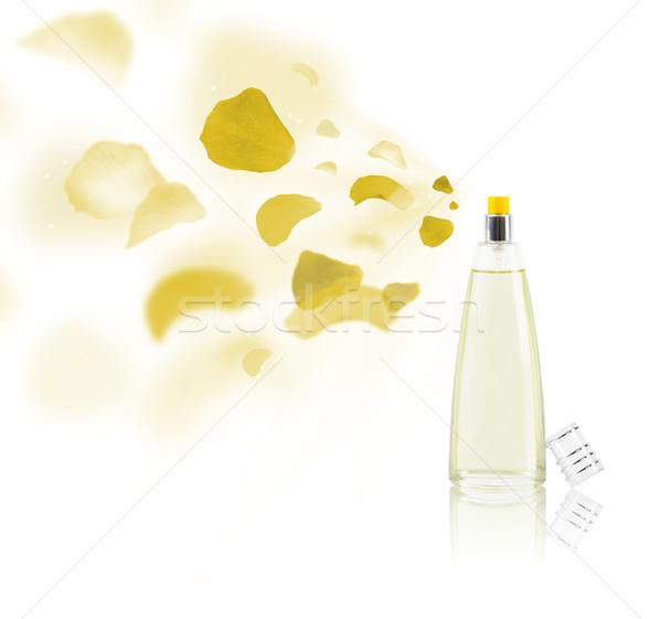 erfume bottle spraying rose petals Stock photo © ra2studio