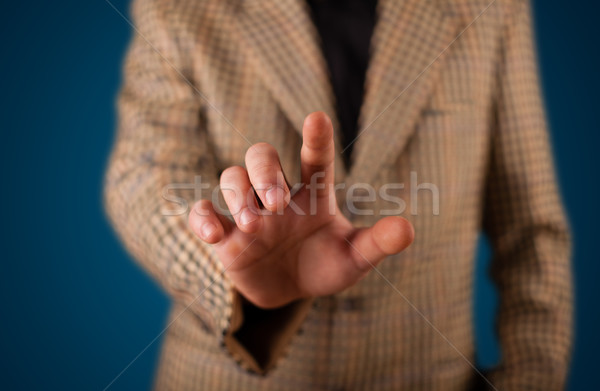 Businessman pressing imaginary button Stock photo © ra2studio