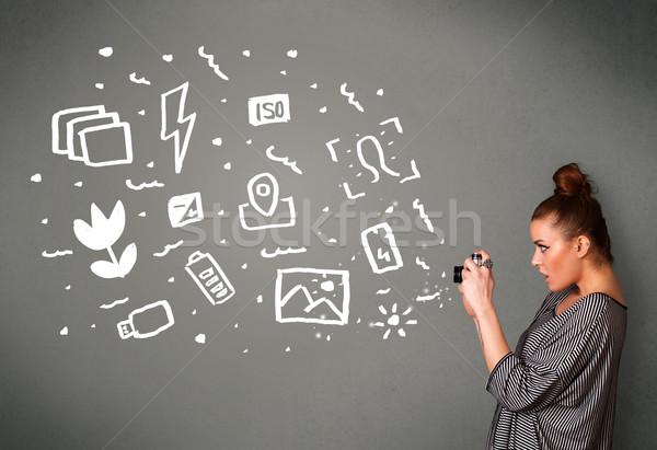 Photographer girl capturing white photography icons and symbols Stock photo © ra2studio