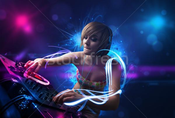 диск-жокей играет музыку световыми эффектами фары красивой Сток-фото © ra2studio